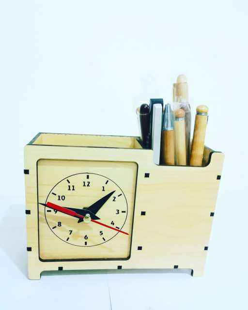 Wooden watch with pen holder