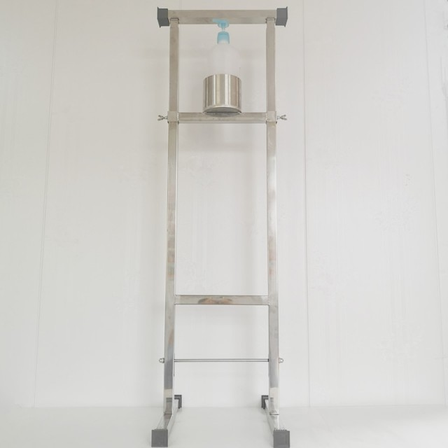 Touch free foot operated hand sanitizer dispenser